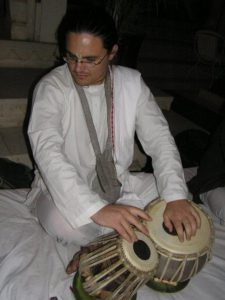 Me playing the tabla at the Shiv Niwas Palace, Udaipur, India
